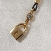 as86 3 bijoux seins cadenas or.jpg