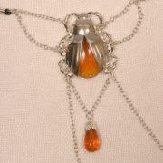 st105 3 strings scarabees sacres argent.jpg