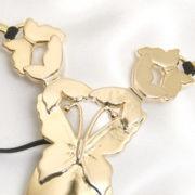 st121 4 string papillons de jouissances col or.jpg