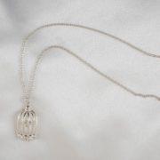 Love's cage pendant silver